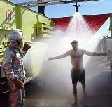 A man taking a shower after being contaminated.